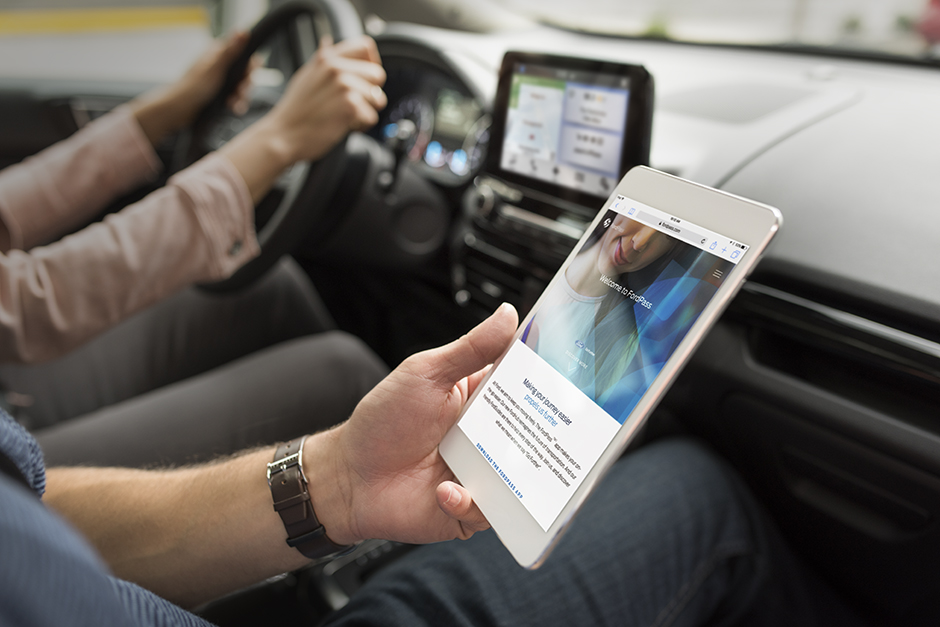 Photo of a passenger using an iPad in a vehicle